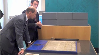 Paul Stebbing shows Prince Edward a huge document placed on the map table, erected by my OH, in the Archives