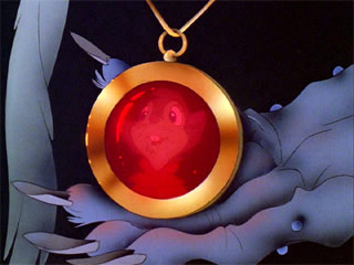 Nicodemus holding the amulet Secret of NIMH 1982 animatedfilmreviews.blogspot.com