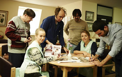Derek cast on set signing DVDs and posters