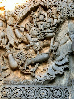 Vishnu and Lakshmi on Garuda the eagle, the vehicle of Vishnu Halebid, Karnataka.