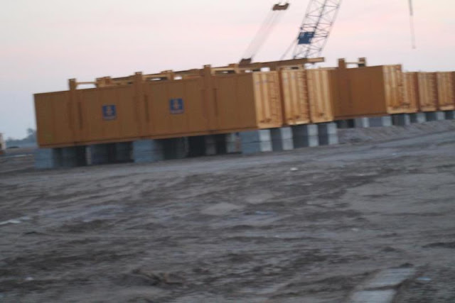 Picture of yellow construction trailers on the Kingdom Tower construction site