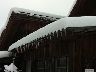 icicle hanging from the snoy roof