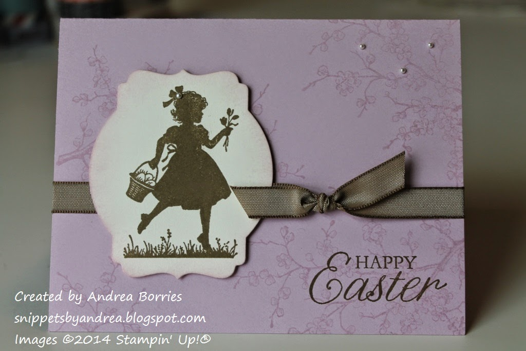 "Pale Plum card stamped with flowering branches in the background. Focal image is a silhouette image of a girl collecting Easter eggs. Brown ribbon and ""Happy Easter"" greeting."