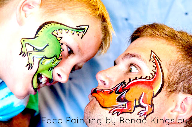 dragons fight, painted dragons, dragon art, ren fair face paint, medievil body art