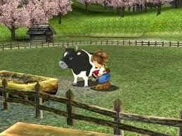 Harvest moon it's a wonderful life special edition game review picture of player milking a cow in a field