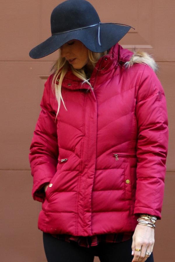 black get floppy hat red jacket