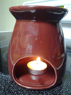 Aroma lamp.  Step 6:  Find an aroma lamp that works well for you. (It can be run by tea lights or light bulbs)