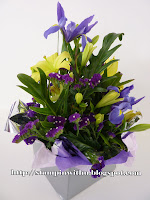 Purple and yellow Box of Flowers