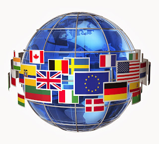 A globe surrounded by flags of the world.