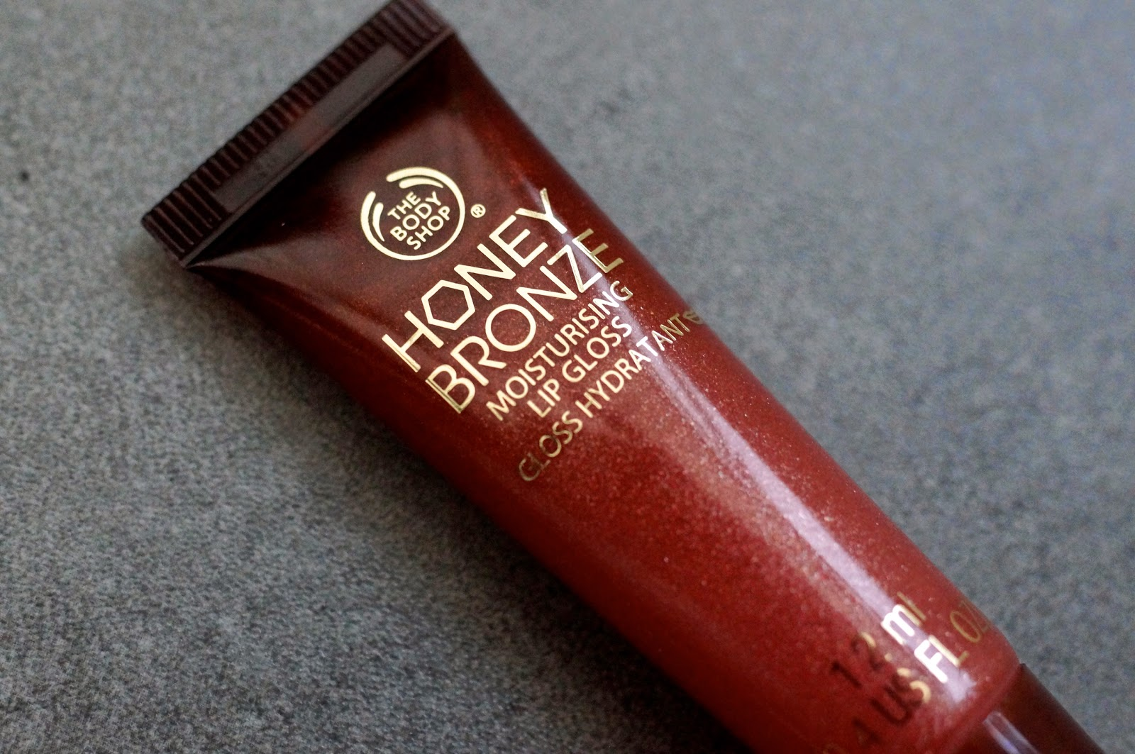 Honey Bronze Lip Nectar In Coral the body shop