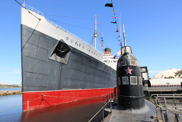 The front view of the Russian Scorpion Submarine and Queen Mary's cruise ship as I am staying on top of the submarine at Long Beach, Los Angeles, California, USA