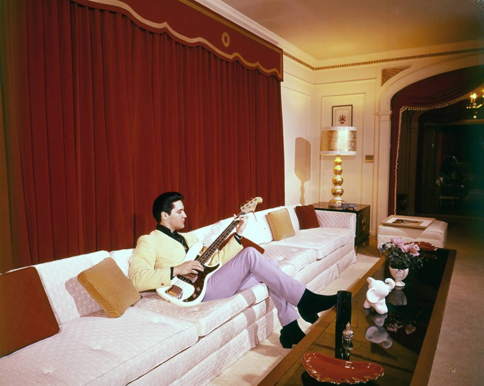 elvis fingered an electric bass inside graceland in this photograph