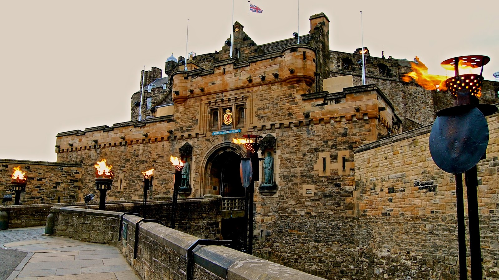 Torches burn at the gatehouse of Edinburgh Castle