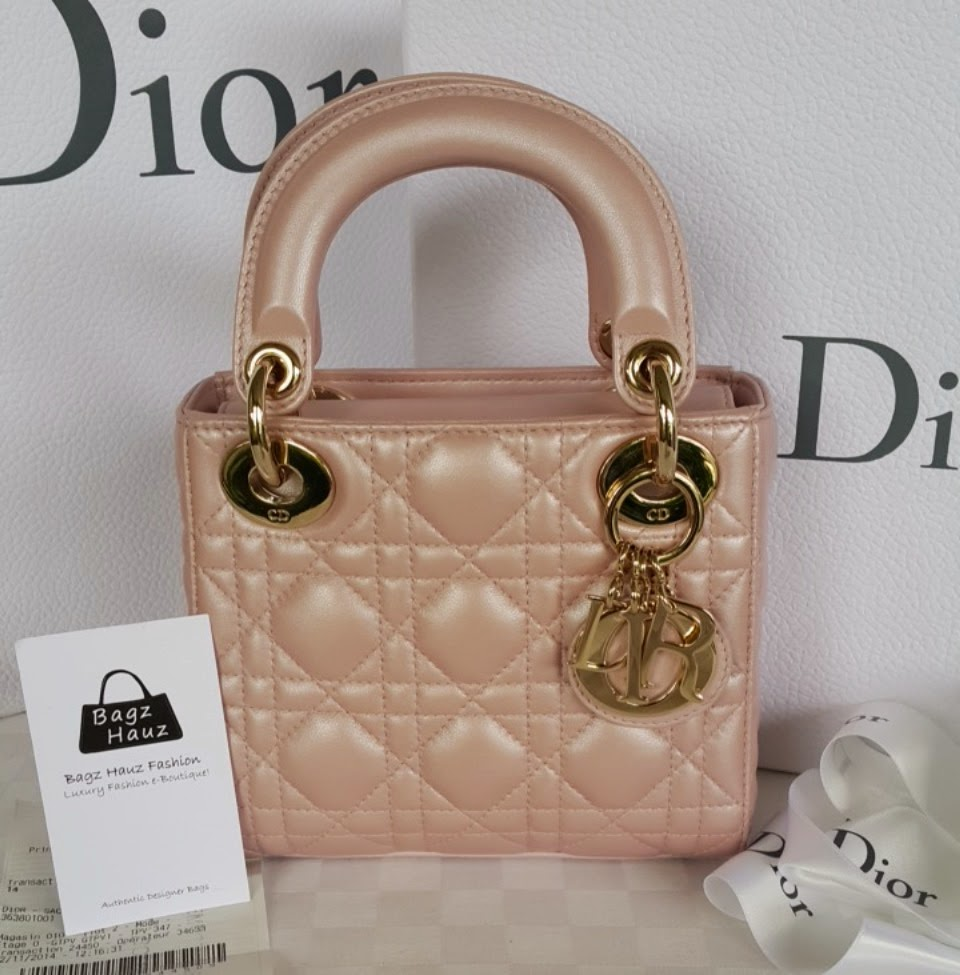 DIOR Mini  Lady Dior  in Pearlised Lambskin - Color  Lotus Pink (comes with  new metal chain strap which has been wrapped securely by our SA af1c89934d71e