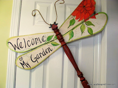 welcome sign painted on dragonfly wings