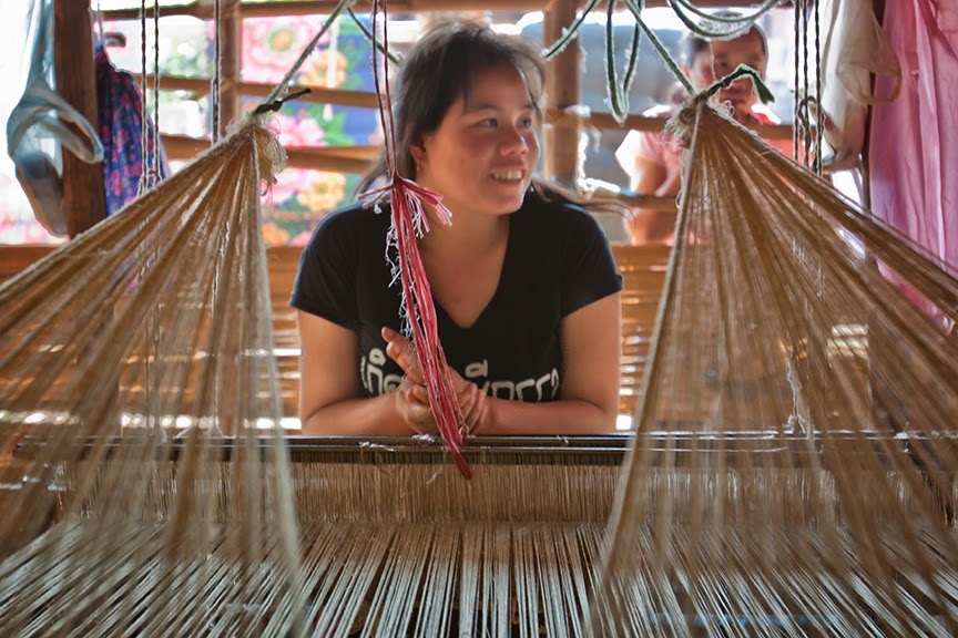 Young Lao village weaver at her loom