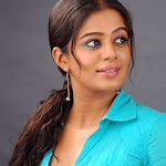 Priyamani in Blue Shirt & White Pant Stills