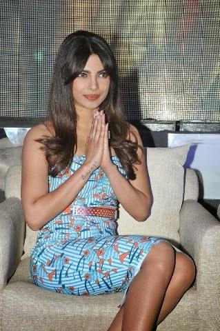 Priyanka Chopra hot bollywood actress sexy cross-leged pics tight dresses skirts upskirt pics