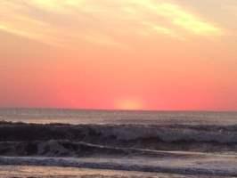 en la playa de cariló con un amanecer