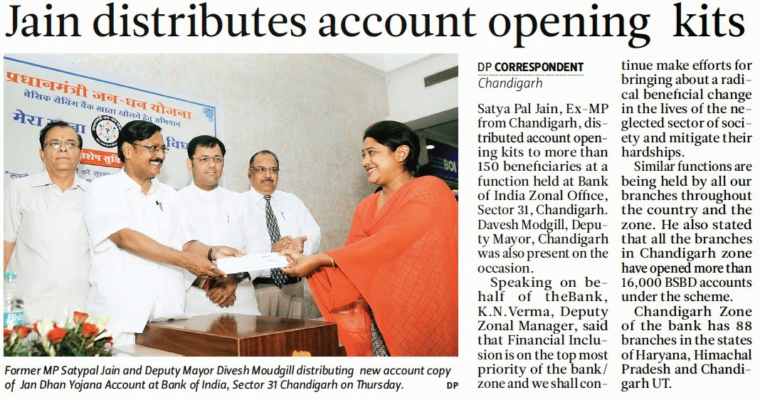 Former MP Satya Pal Jain and Deputy Mayor Davesh Moudgill distributing new account copy of Jan Dhan Yojana Account at Bank of India, Sector 31, Chandigarh on Thursday.