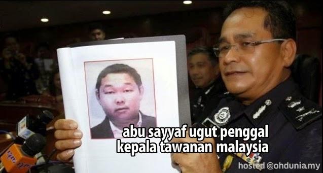 Kumpulan Abu Sayyaf Ugut Untuk Penggal Kepala Tawanan Malaysia