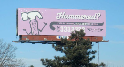 Lavender billboard with a cartoon hammer and the word Hammered?