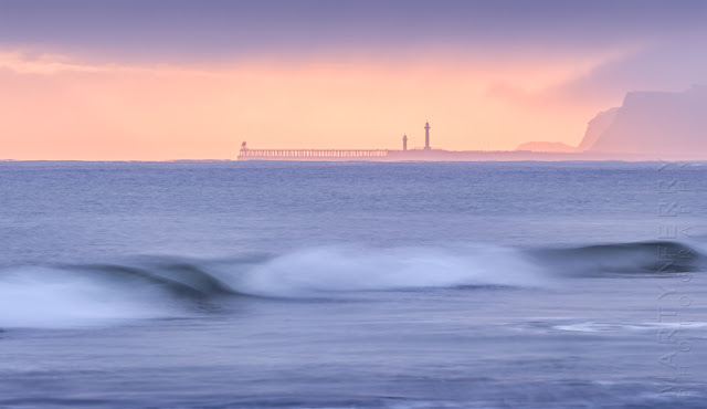 Photograph of Whitby piers in the morning fog at sunrise by Martyn Ferry Photography