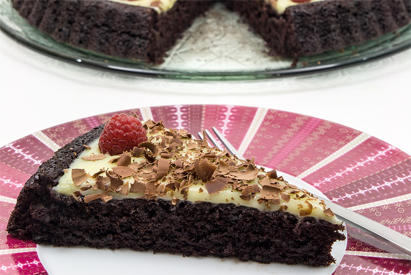Triple chocolate cake raspberry one pisece close
