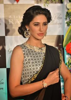 Nargis Fakhri wow Beautiful Saree Pics with a Sleeveless Full Neck Blouse and Black Saree