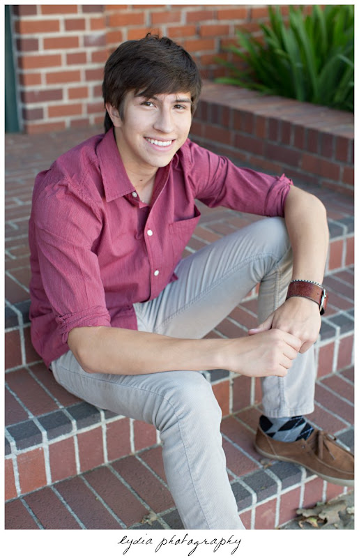 Senior guy sitting on brick steps at Forest Lake Christian senior lifestyle portraits in Rocklin, California
