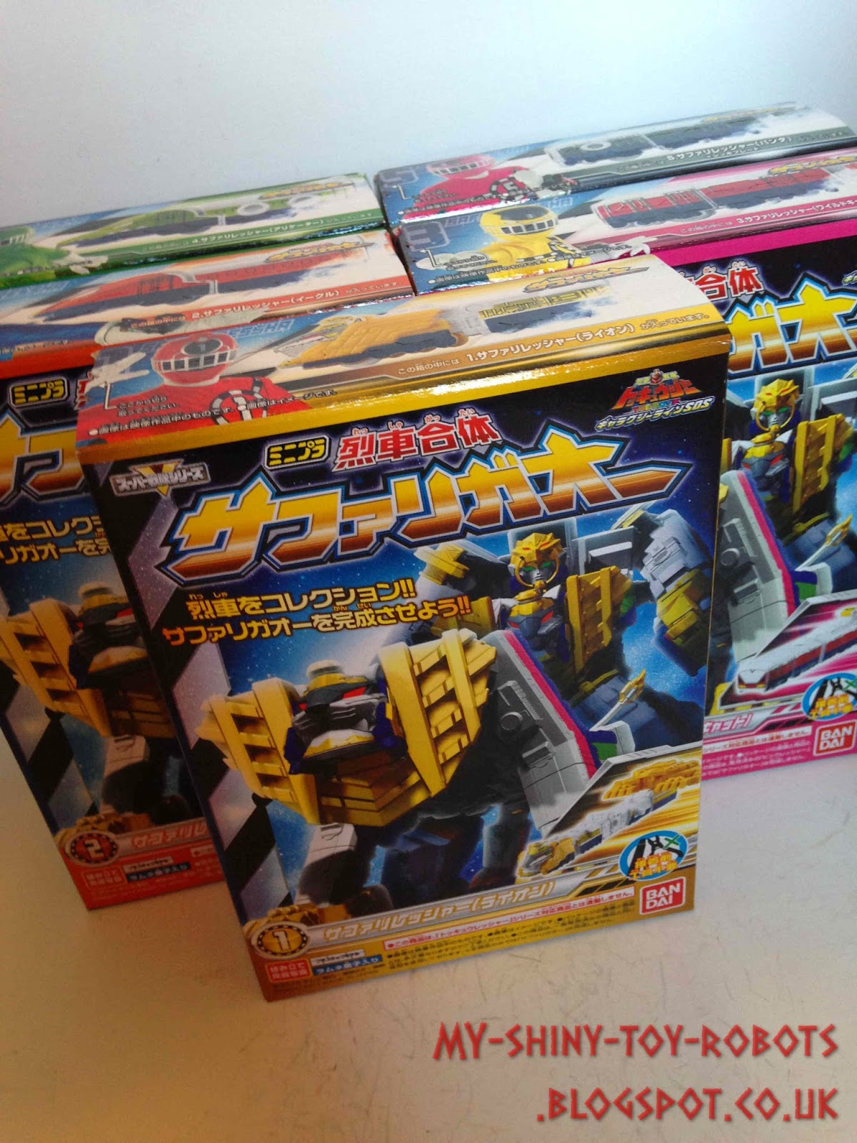 The five model kits in their boxes