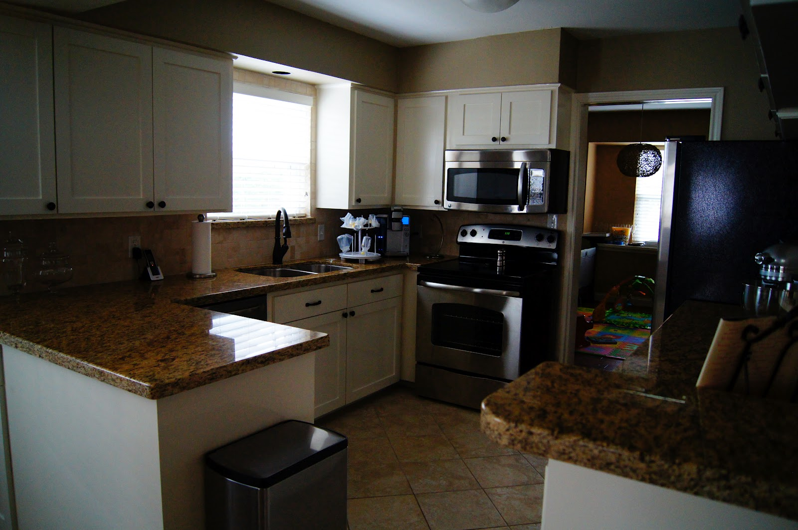 Granite countertops (Santa Cecilia), Shaker Style cabinets, Tumbled