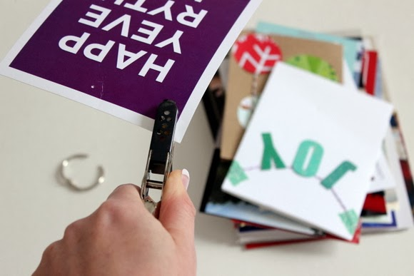 Then you just use the hole punch to make a hole in each card! Making the Christmas Card book could not be easier!