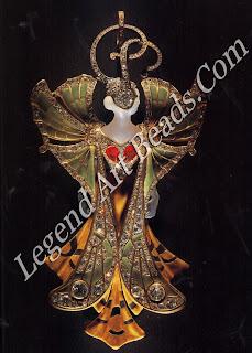 "An elaborate pendant of 1900 called ""Silvia"": gold, agate, ruby, enamel and brilliant-cut diamonds."