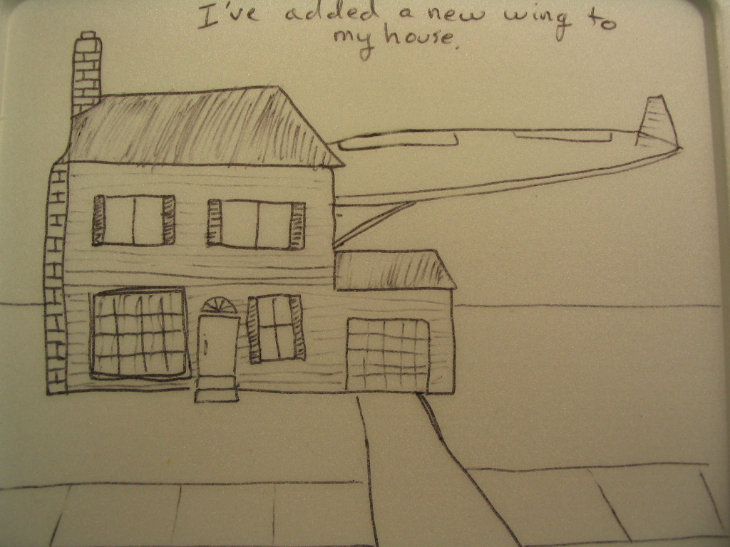 A house with an airplane wing on it.  The caption says I've added a wing onto my house.