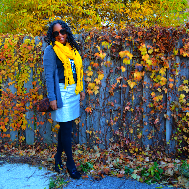 yellow scarf worn with grey cardigan