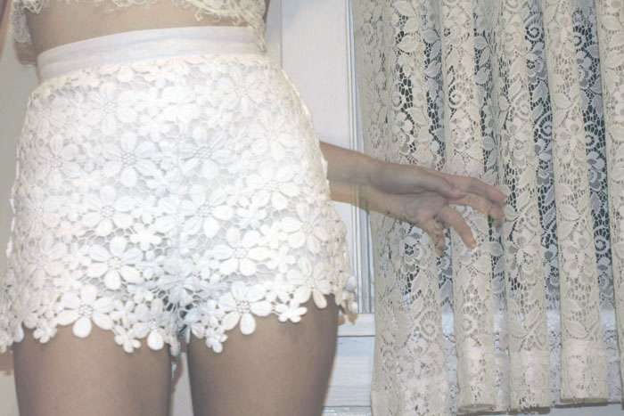 Wearing Shakuhachi Daisy Chain Highwaisted Shorts and Zinke Lace Crop Bralette