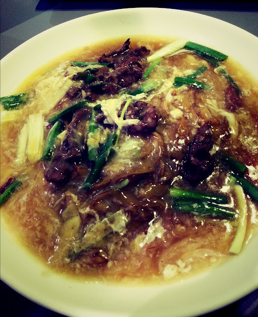 Beef flat noodle row six melaka