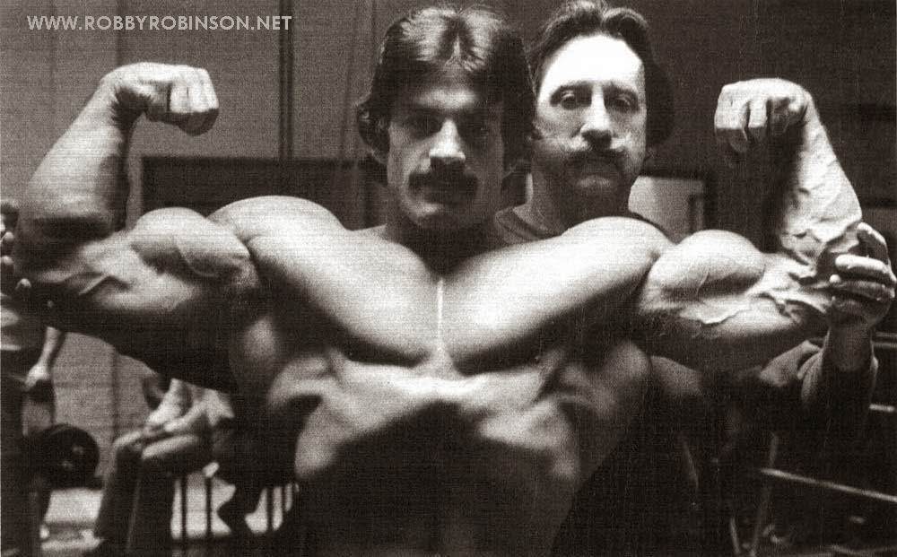 "MIKE MENTZER AND JOE WEIDER - POSING WORKOUT AT GOLD'S GYM VENICE; CA '70s Read about RR's training and life experience, about other legends of Golden Era of bodybuilding and what really happened behind the scenes of Weider's empire - in RR's BOOK ""The BLACK PRINCE; My Life in Bodybuilding: Muscle vs. Hustle"" ● www.robbyrobinson.net/books.php ●"