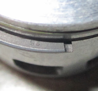 "Close up of the ""25"" mark on the second piston ring - Yamaha two stroke"