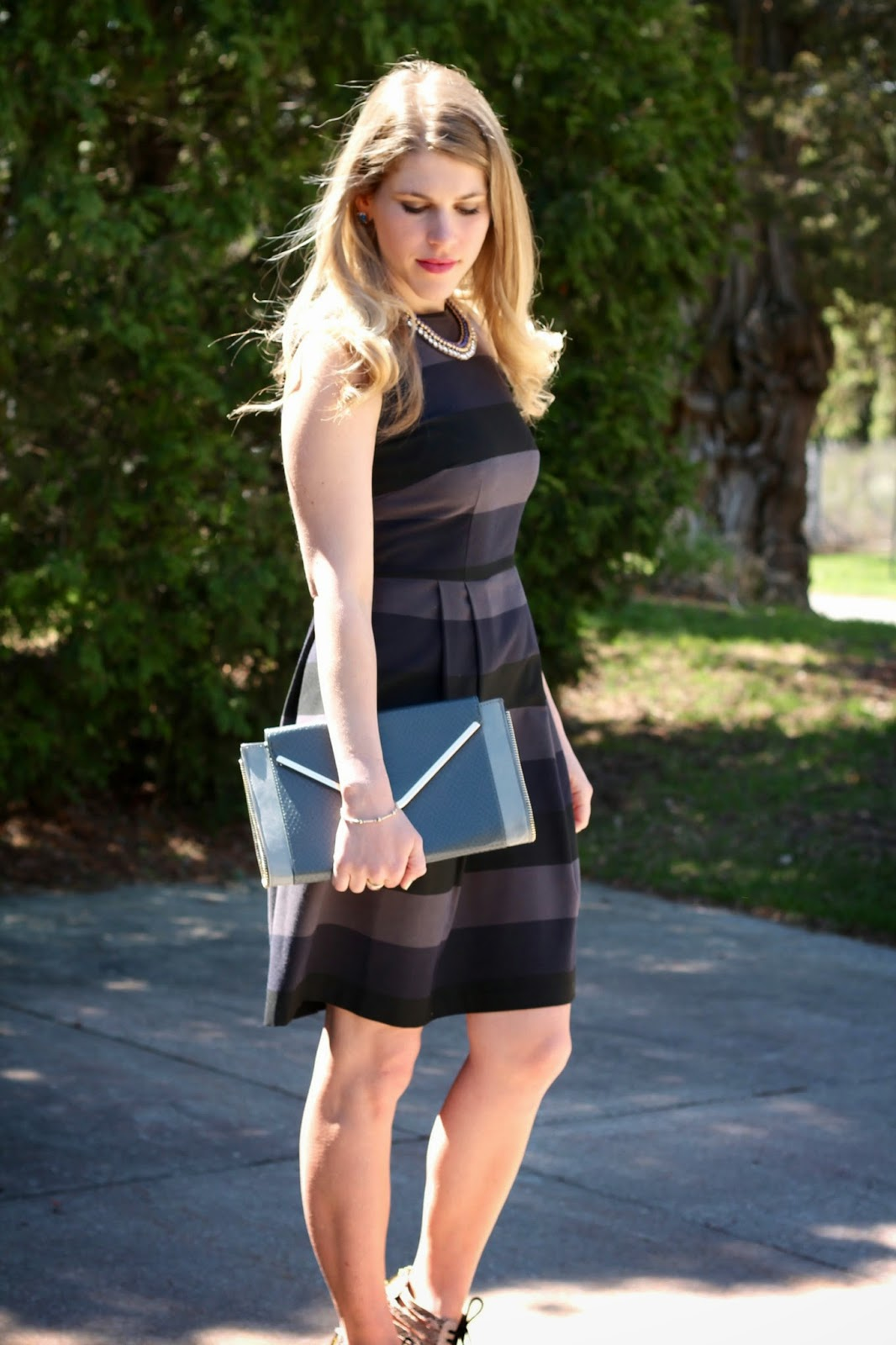 navy black striped dress, lace up heels, gray envelope clutch, blue necklace