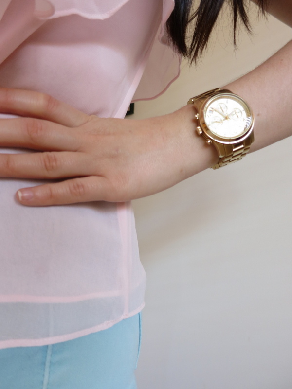 Mint jeans, pink singlet, denim jacket and gold jewellery