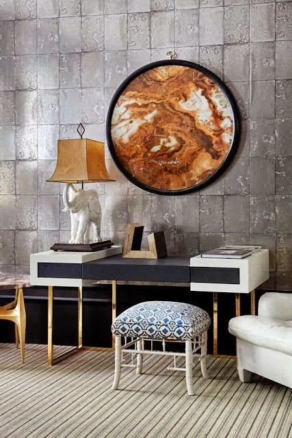 beautiful stone wall living room with gold and modern art vignette