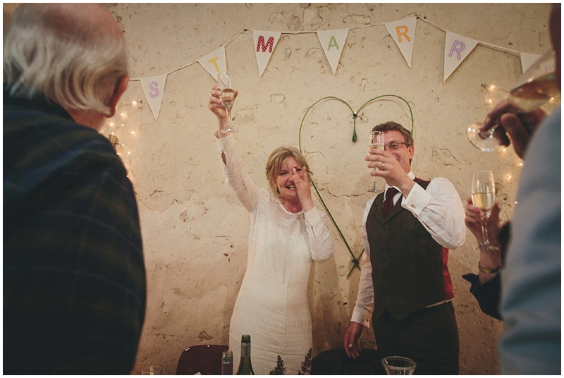 Bride and groom toast guests