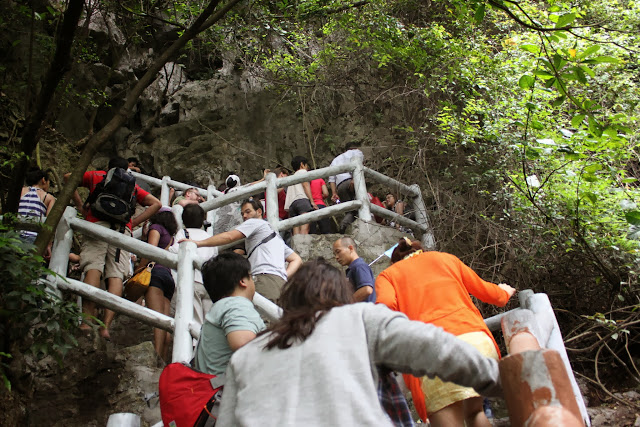 Walking up the flight of stairs to Thien Cung Grotto at Halong Bay in Hanoi, Vietnam