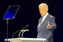 Man with teleprompter, each apparering empty of things to say, yet, comfortable in the pairing