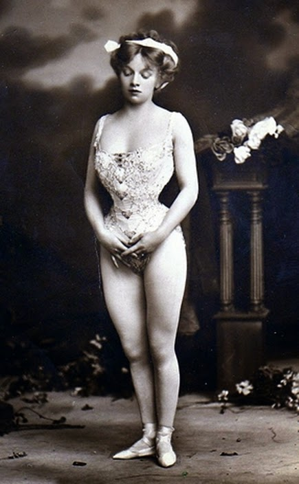 Vintage glamour photo pf woman with a very small waist