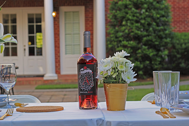 pink wine and flowers on table | Cordier Event Planning