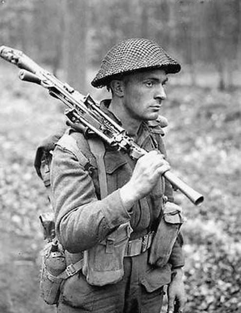 Private  DB MacDonald-Royal Canadian Regiment-Oct 1943 Campobasso Italy-holding Bren gun