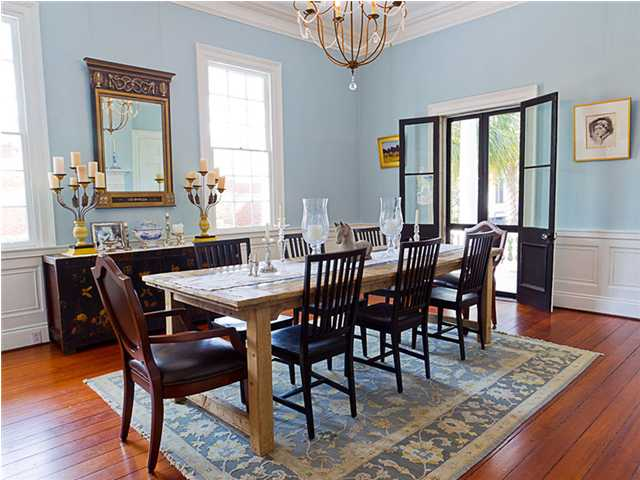 Main dining room with wooden table and chairs